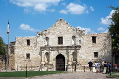 Tourists At The Alamo Texas. SAN ANTONIO, TEXAS - AUGUST 22, 2015: Tourists line up to visit The Alamo in San Antonio, Texas, USA, on August 22, 2015 Royalty Free Stock Image