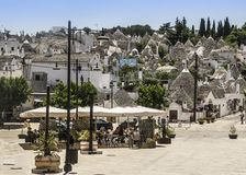 Tourists at alberobello doing shopping Royalty Free Stock Image