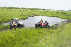 Tourists on all-terrain vehicles. On ATV Royalty Free Stock Images