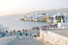 Tourists along Mykonos waterfront overlook little Venice Stock Images