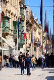 Tourists along Republic Street, Valletta. Royalty Free Stock Image