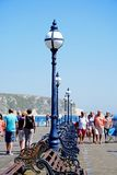 Tourists along Swanage pier. Royalty Free Stock Image