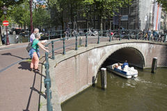 Tourists in Amsterdam Royalty Free Stock Photography