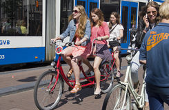 Tourists in Amsterdam Royalty Free Stock Image