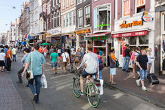 Tourists in Amsterdam shopping and looking for a restaurant Stock Photos