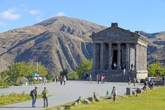 Tourists at Ancient hellenistic Garni pagan Temple in Armenia Royalty Free Stock Images