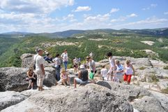 Tourists at the ancient Thracian city Perperikon Royalty Free Stock Photos