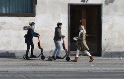 Free Tourists And Local Ride Electric Scooter In Copenhagen Stock Photos - 144835283