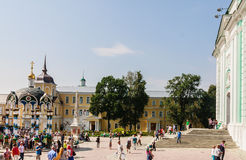 Tourists And Parishioners Around The Bell Tower. Holy Trinity-St. Sergiev Posad Stock Images