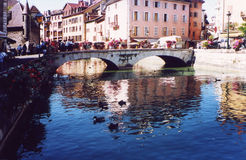 Tourists in Annecy  (Haute Savoie - France). Tourists walking on bridge in Annecy Royalty Free Stock Photography
