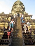 The tourists apply social distancing when going through the steep steps