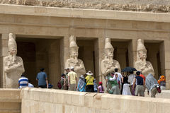 Tourists approach the upper terrace at the Temple of Hatshepsut at Deir al-Bahri near Luxor in central Egypt. Royalty Free Stock Photos