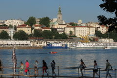Tourists approaching famous Belgrade restaurants on river Stock Photography
