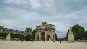 Tourists approaching and going through triumphal arch, Place du Carrousel, Paris. Stock footage stock footage