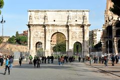 Tourists at The Arch of Constantine in Rome, Italy. Tourists visiting an photographing monument of the Arch of Constantine, Rome, Italy Stock Photo