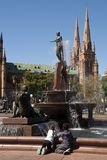 Tourists at the Archibald Fountain with St Marys cathedral in the background stock photo