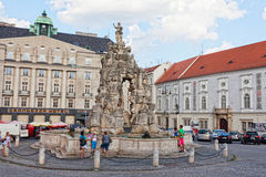 Tourists on the area the Cabbage market at the fountain Parnassus, Brno Stock Photo