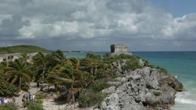 Tourists are walking in archaelogical ruins of Tulum stock images