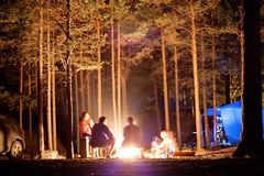 Tourists around the campfire at night. Royalty Free Stock Photos
