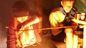 Tourists around the campfire at night. stock footage