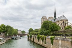 Tourists around the Notre Dame cathedral along river Seine in Paris Royalty Free Stock Image
