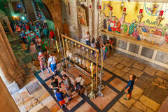Tourists around Stone of Anointing in the Church of the Resurrec Royalty Free Stock Photography