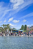 Tourists around water basin on Museum Square, Amsterdam, Netherlands Stock Photography