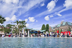 Tourists around water basin on Museum Square, Amsterdam, Netherlands Royalty Free Stock Images