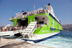 Tourists arrive from big ferryboat in the port Santorini, Greece Stock Photo