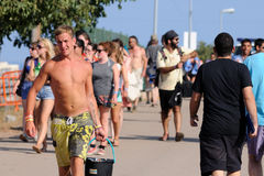 Tourists arrive to the beach and camping of the FIB Festival Stock Photo