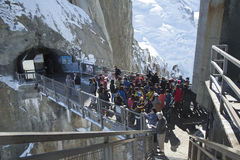 Tourists arrived by cable car at the central footbridge at the Aiguille du Midi Stock Image