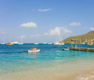 Tourists arriving ashore at tony gibbons beach in the windward islands Royalty Free Stock Photography