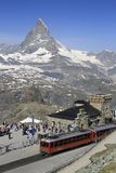 Gornergrat Railway final Station and Matterhorn view, Switzerland. Tourists arriving in Gornergrat Railway final station, enjoying the Matterhorn view and royalty free stock images