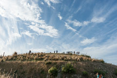 Tourists on and arriving at peak of Mount Victoria Wellington Ne Stock Photo
