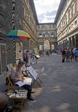 Tourists and artists in the courtyard gallery Uffizi in Florence Stock Image