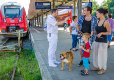 Tourists ask for directions at train station in Warnemunde Stock Photography