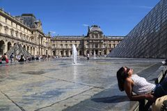 Tourists At The Louvre Museum In Paris, France Stock Photos