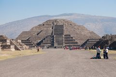 Tourists on the Avenue of the Dead at the Pyramid of the Sun in Royalty Free Stock Photo