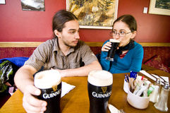 Tourists in Avoca's Fitzgerald pub Royalty Free Stock Image