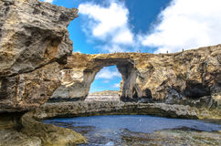 Tourists on the Azure Window in Malta. Natural Arch in Dwejra Bay, Gozo, on the Mediterranean Sea Royalty Free Stock Images