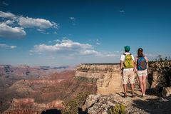 Tourists with backpack hiking at Grand Canyon Royalty Free Stock Photo