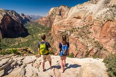 Tourists with backpack hiking in Zion Royalty Free Stock Photos