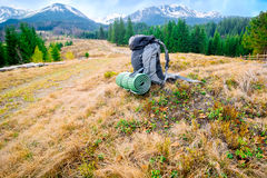 Tourists backpack in mountains landscape Royalty Free Stock Photo