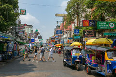 Tourists and backpackers walk on Khao San Road in Bangkok, Thailand. Bangkok, Thailand - March 5, 2017: Tourists and backpackers walk on Khao San Road in Bangkok stock photo