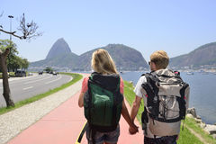 Tourists backpackers walking through Rio de Janeiro. Royalty Free Stock Image