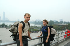 Tourists with backpacks. Tired pair tourists with backpacks Royalty Free Stock Photography