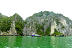 Tourists bamboo boat near the islands of ha long bay Vietnam. A tourists boat sailing near the islands of ha long bay Vietnam Royalty Free Stock Image