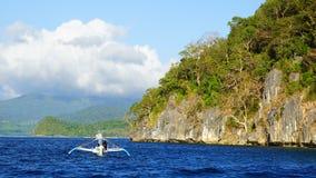 Tourists on bangka at Island. Stock Photography
