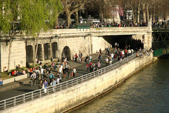 Tourists at the bank of Seine river in Paris Stock Photography