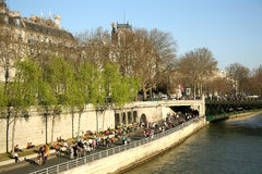 Tourists at the bank of Seine river in Paris Stock Photo